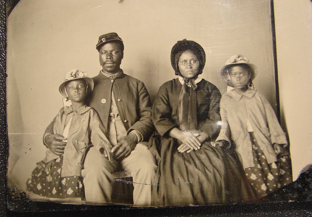 Unidentified African American soldier in Union uniform with wife and two daughters, c. 1863-1865