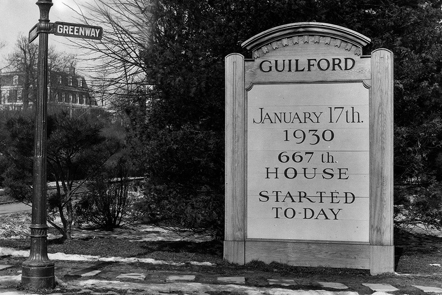 A sign on Greenway commemorating the groundbreaking of Guilford's 667th house on January 17, 1930. Courtesy Sheridan Libraries Special Collections, Johns Hopkins University.
